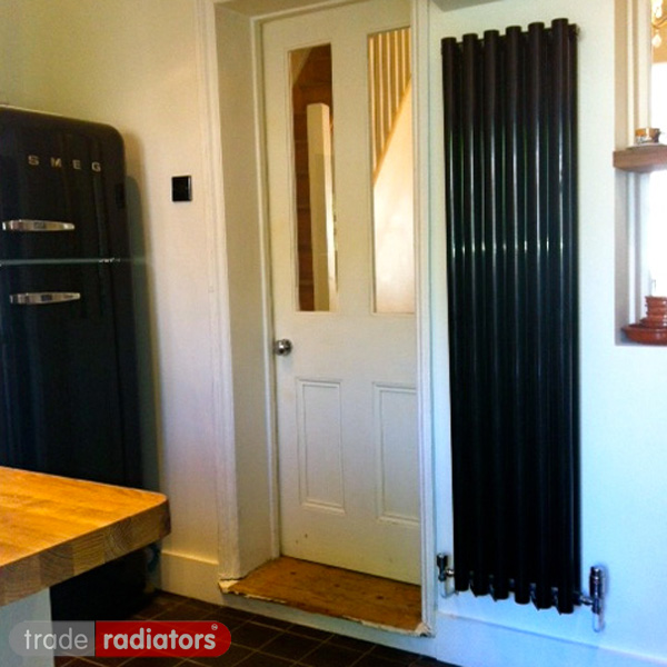 Black Vertical Radiator installed in a kitchen