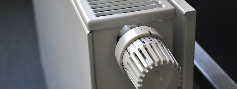 A white convector radiator with thermostatic radiator valve to help keep your heating costs down.