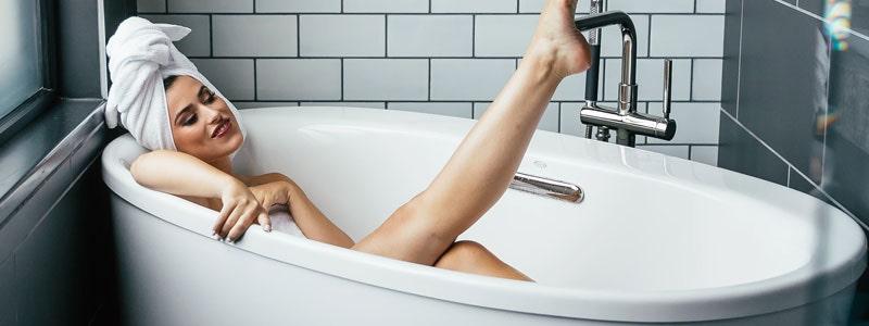 A woman relaxing in a bath
