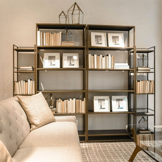 A bookshelf that is correctly not placed in front of a radiator.