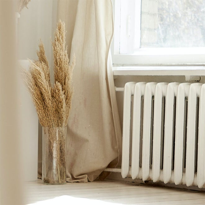 A curtain hanging very close in front of a radiator