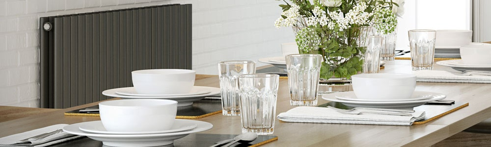 A horizontal anthracite kitchen radiator next to a dining table