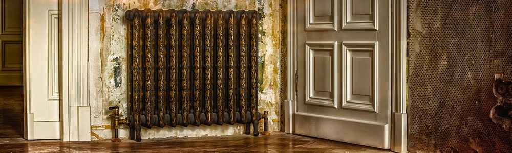 A vintage radiator in a Victorian-style room